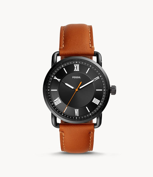 The orange-brown leather attaches the stark black case and round bezel. The black face of the watch creates dimension and allows for the white Roman numerals and hands to standout.