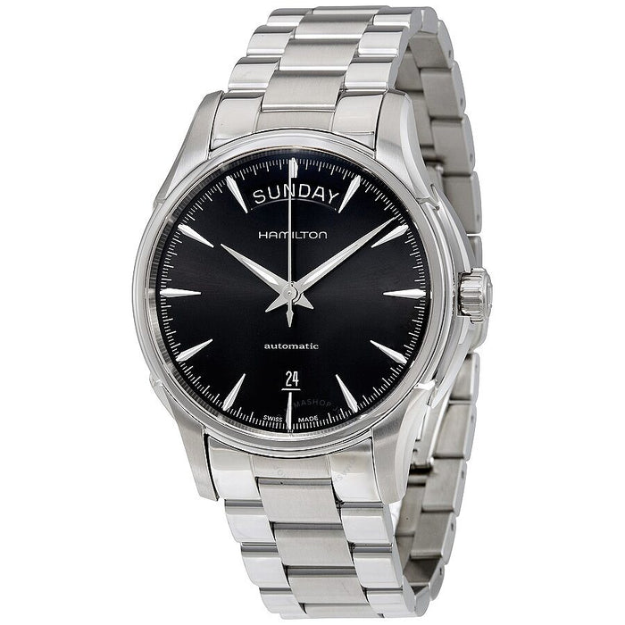 The contrast between the black dial and silver hands, case, and strap creates a bold statement while the medium size allows for a more casual style. There are no numerics which creates a sleek aesthetic while the bold day date at the top of the dial can't be missed. This watch is completely versatile and fits any occasion.