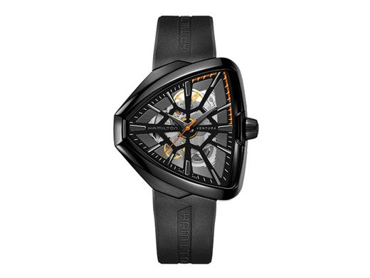 This incredibly distinctive style watch has an almost triangular face shape with a spider web like design on the dial that allows the wearer to peer into the heart of the watch. The strap is seamlessly attached to the case without a buckle and the black monochromatic style creates a sleek aesthetic.