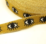 Gold-colored stretch band with eyes - € 5 / m