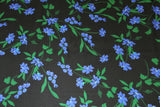Black viscose with blue flowers - €19,9/m