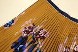 Ocher yellow pleated fabric with large floral print - piece of 110 by 70cm - € 43