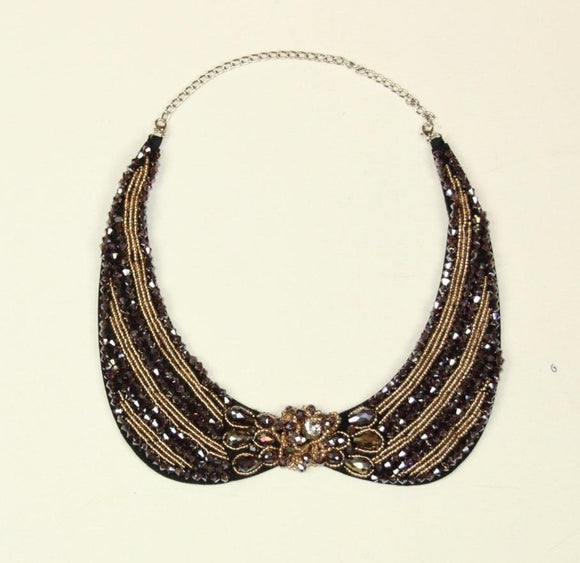 Collar with blue and gold colored stones - € 15,9 / piece