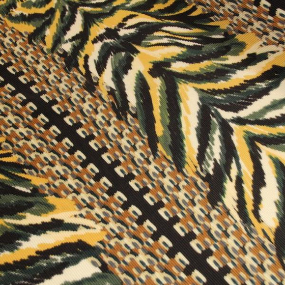 Fine pleated fabric with yellow and green print - 49,5 € / m