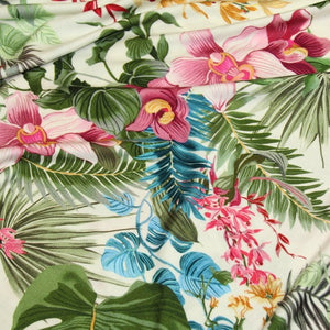 Off-white jersey with tropical flowers - €18/m
