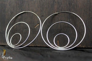 circular hoops handcrafted in sterling silver with rhodium finish