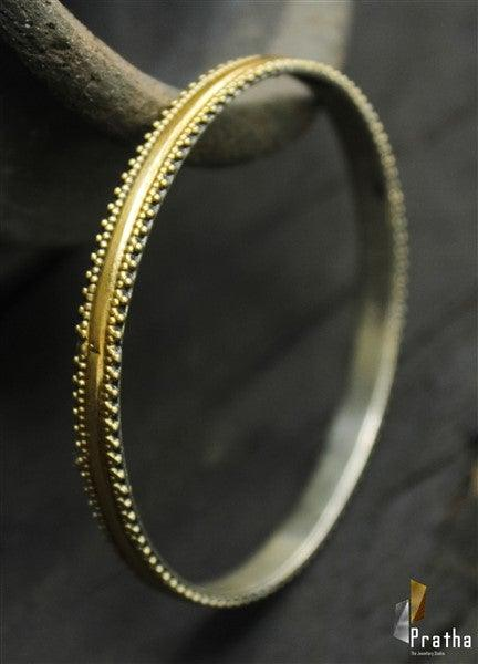 simple dual tone bangle handcrafted in sterling silver with delicate design around