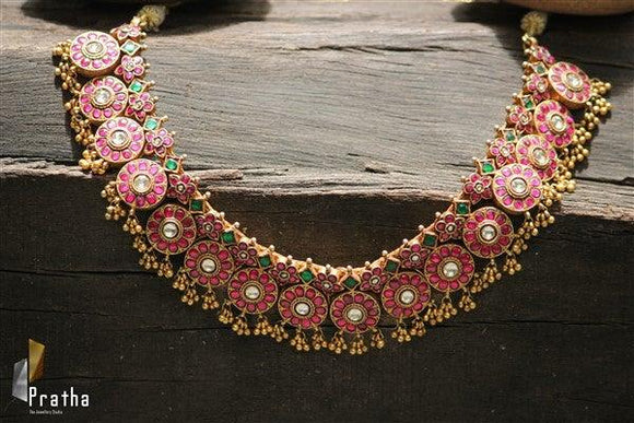 Handcrafted gold plated silver kundan neck piece embellished with synthetic stones.