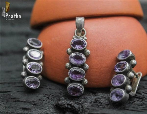 Ethnic semiprecious amethyst stone pendant set handcrafted in sterling silver is a versatile piece can be combined with Indian as well as western outfit.