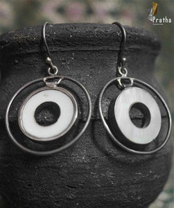 simple circular earrings handcrafted in sterling silver with easy to wear hooks