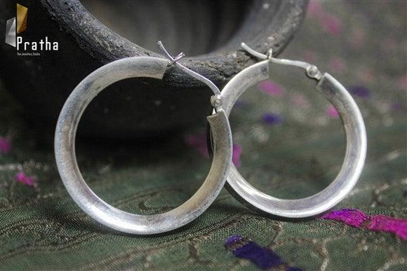 simple round hoops handcrafted in sterling silver