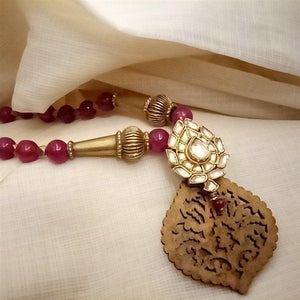 gold polished synthetic aventurine red beads with wood peace attached kundan pendant mala