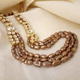 gold polished kundan side peace and golden beads three line necklace