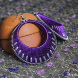 a fancy vibrant colour thread work earring very neatly handcrafted in sterling silver.