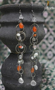 Dainty sterling silver handcrafted earrings with semiprecious stones giving it a classy look.