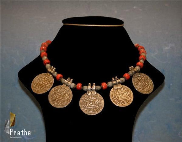 silver mohar with urdu inscriptions strung together in coral & grey colour beads