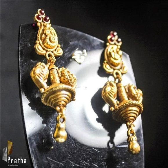 Temple gold plated earrings handcrafted in sterling silver with peacock motive & kundan embellishments.