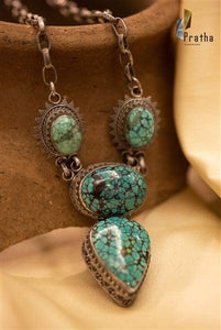 Add the colour of royalty to your look, Turquoise semiprecious stone neck piece handcrafted in sterling silver.