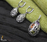 Drop shape pendant set handcrafted in sterling silver with multicolour stones for your formal everyday wear requirement .