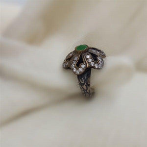 Copper look flower ring with Synthetic green stone