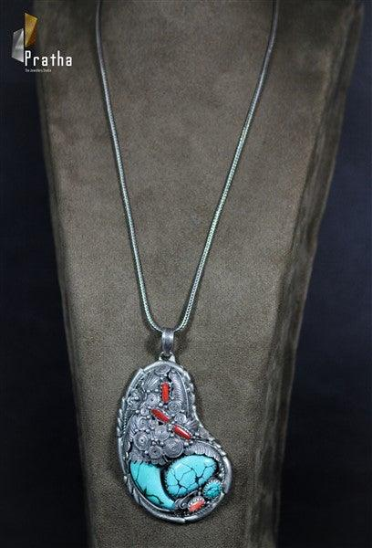 a natural stones turquoise & coral pendant handcrafted in sterling silver