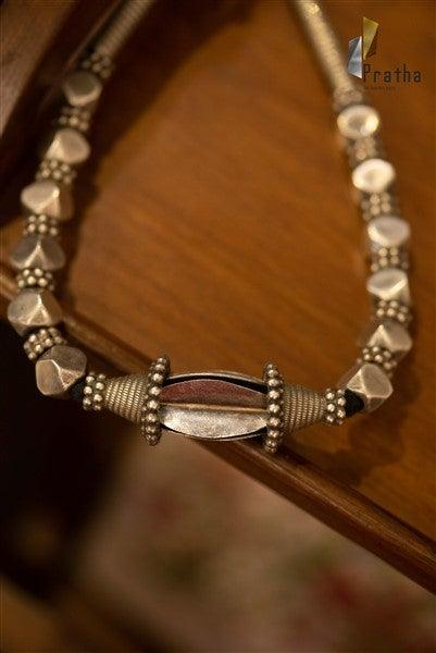 Add an ethnic touch to your look with this simple & classy bead necklace handcrafted in sterling silver.