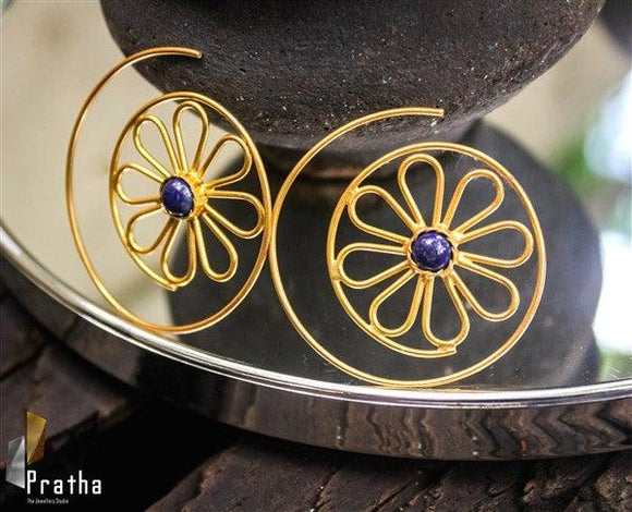 The spiral flower earrings are light weight  perfect for those days when you want to wear something light yet dressy. Handcrafted in sterling silver plated with gold & embellished with blue semiprecious stone.