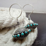 Turquoise colour earring with hanging ball in antique look