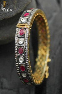 victorian finish bangle with semiprecious rubies & uncut diamonds handcrafted in sterling silver