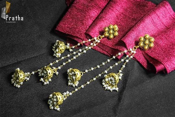 Dainty long jhumka earrings handcrafted in sterling silver plated with gold with fresh water pearls. These earrings are perfect for your traditional outfits combine it with a dress a lehnga or a saree.