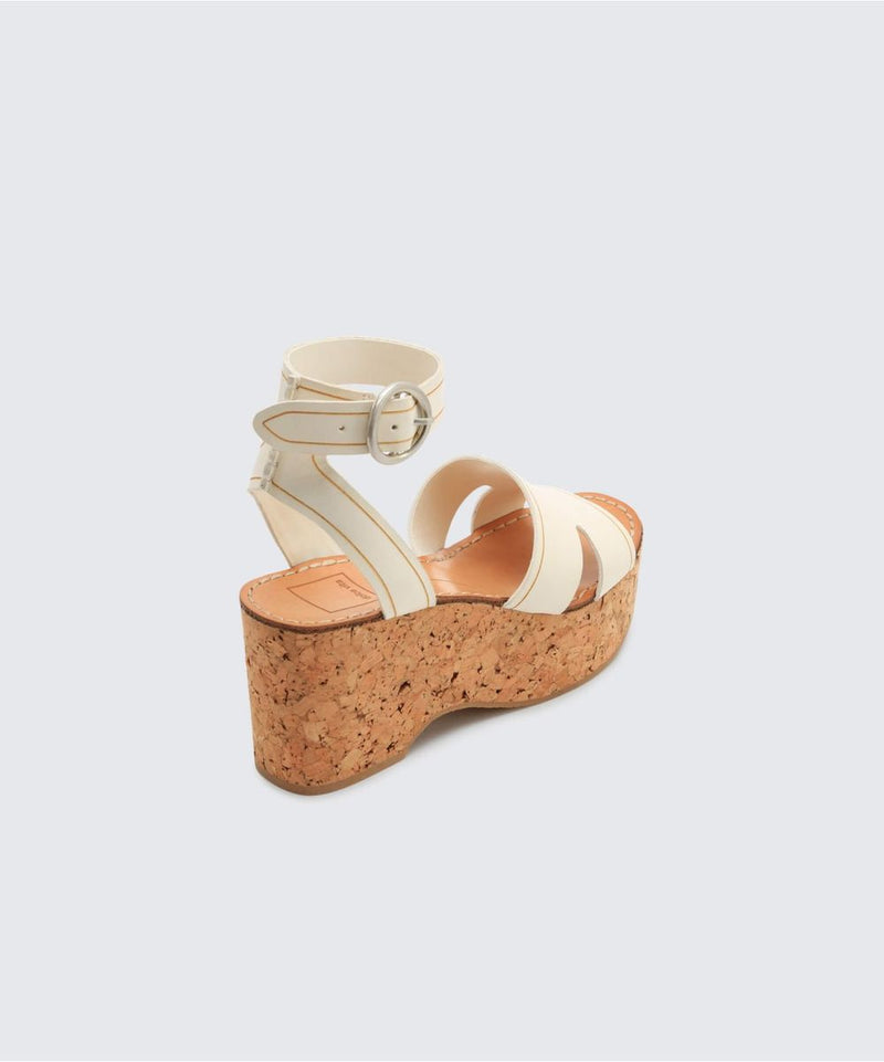 "All about the texture. Linda's cork platform heel brings a subtly 70's twist to Dolce Vita's most sought-after strappy silhouette. 100% Leather. Heel Height: 3"" Cork Buckle. Fits true to size. Dolce Vita is proudly sold at Jax Kendall."