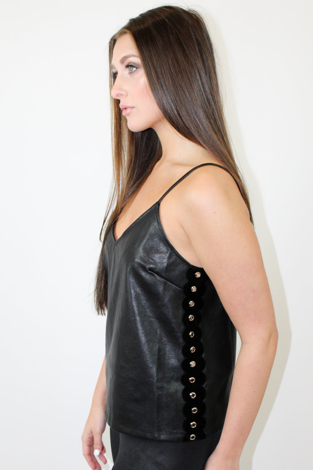 You should be so excited to wear the Cheeky Leather Cami for a girls night out! Pair this top with jeans and heels for an elevated look. The Details: Leather cami. Side scallop contrast. Side grommet detailing. Adjustable shoulder straps. Color: Black. Fits true to size. Care: Hand wash only and lay flat to dry...