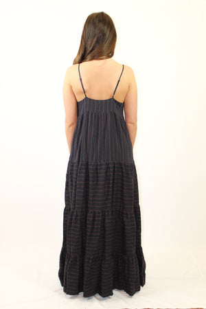 How to Wear: Do you love a flowy feel? This maxi will make all your casual days a step above the rest. Pair with flats, throw your hair up in a messy bun and go. The Details: Midnight Striped. Empire Waistline. Fits very generously. Recommend to size down. Adjustable straps.