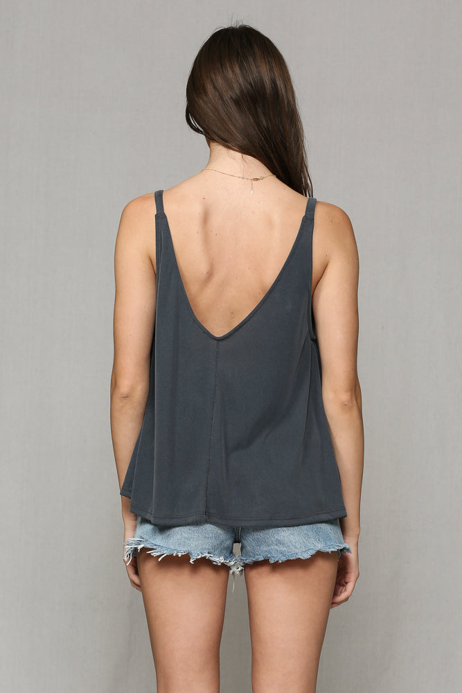 The perfect tank for the Summer and Fall! You can wear this one just about however you want. The washed material makes for a super relaxed feel. Put it with our distressed denim shorts or bells and the Gold Tiki Slides.