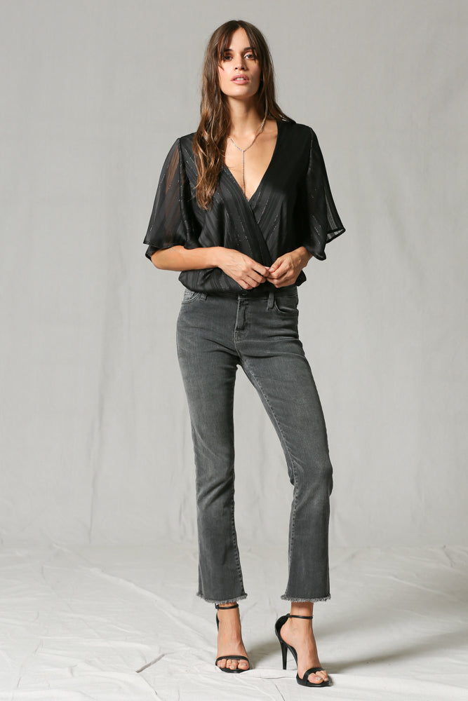 This lightweight bodysuit is going to take you right into Fall from Summer! With a little bit of a nicer feel, you can pair this one with black denim jeans and your favorite heels for a date night or GNO. It would look great with our Take Flight Ankle Flares!
