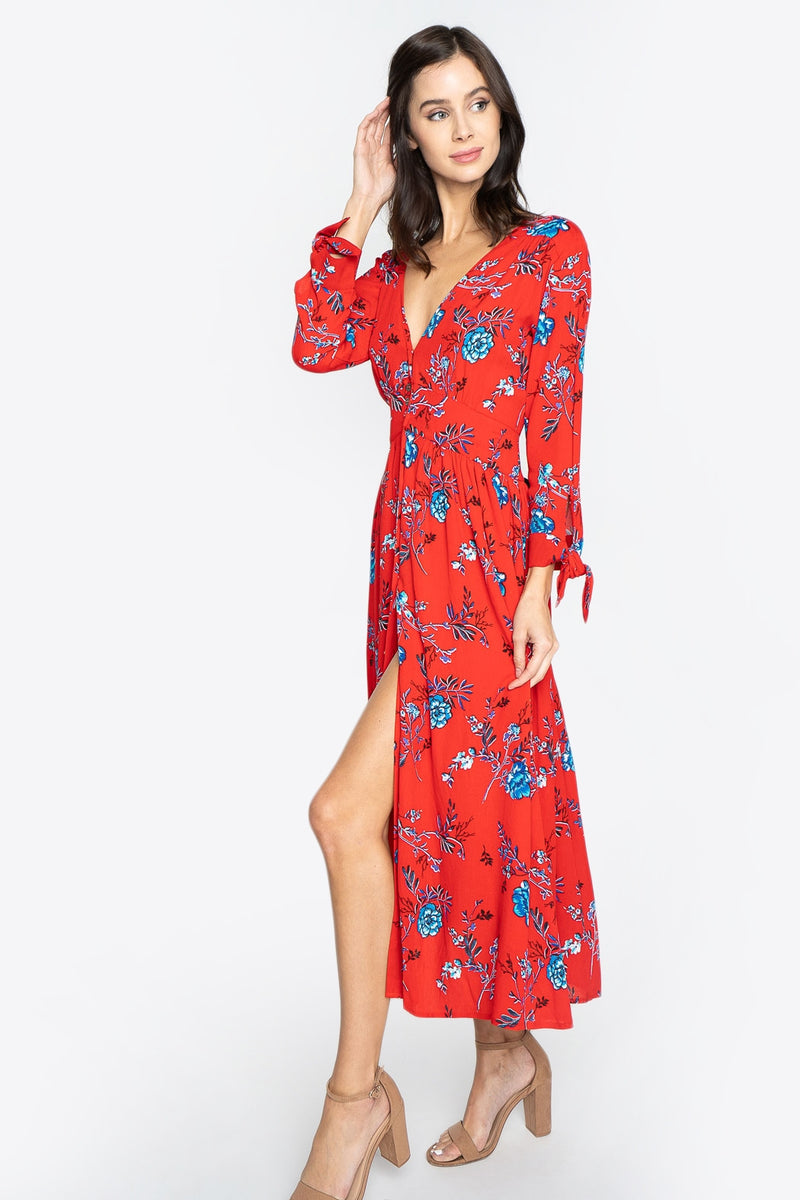 Feel the breeze in the Crimson Rose Floral Midi Dress! Lightweight woven fabric is adorned in a soft red and navy blue floral print, that sweeps from a v-neckline and button up front, leading into three-quarter length sleeves with tie cuff detailing. This flowy midi dress can be paired with heels or ankle strap flats for a casual yet cute vibe.