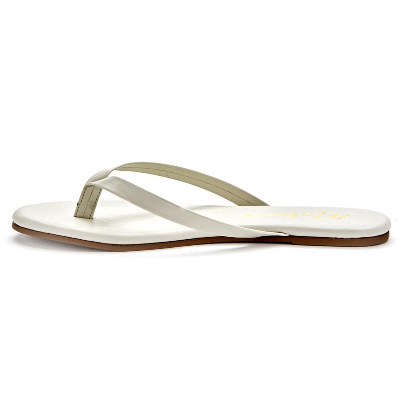 The Laguna is a minimalist flip-flop that offers slim straps and breezy comfort at the beach and beyond. You'll instantly fall into obsession with the ivory color and comfort of this Laguna Collection flip flop. Jax Kendall proudly sells Matisse.