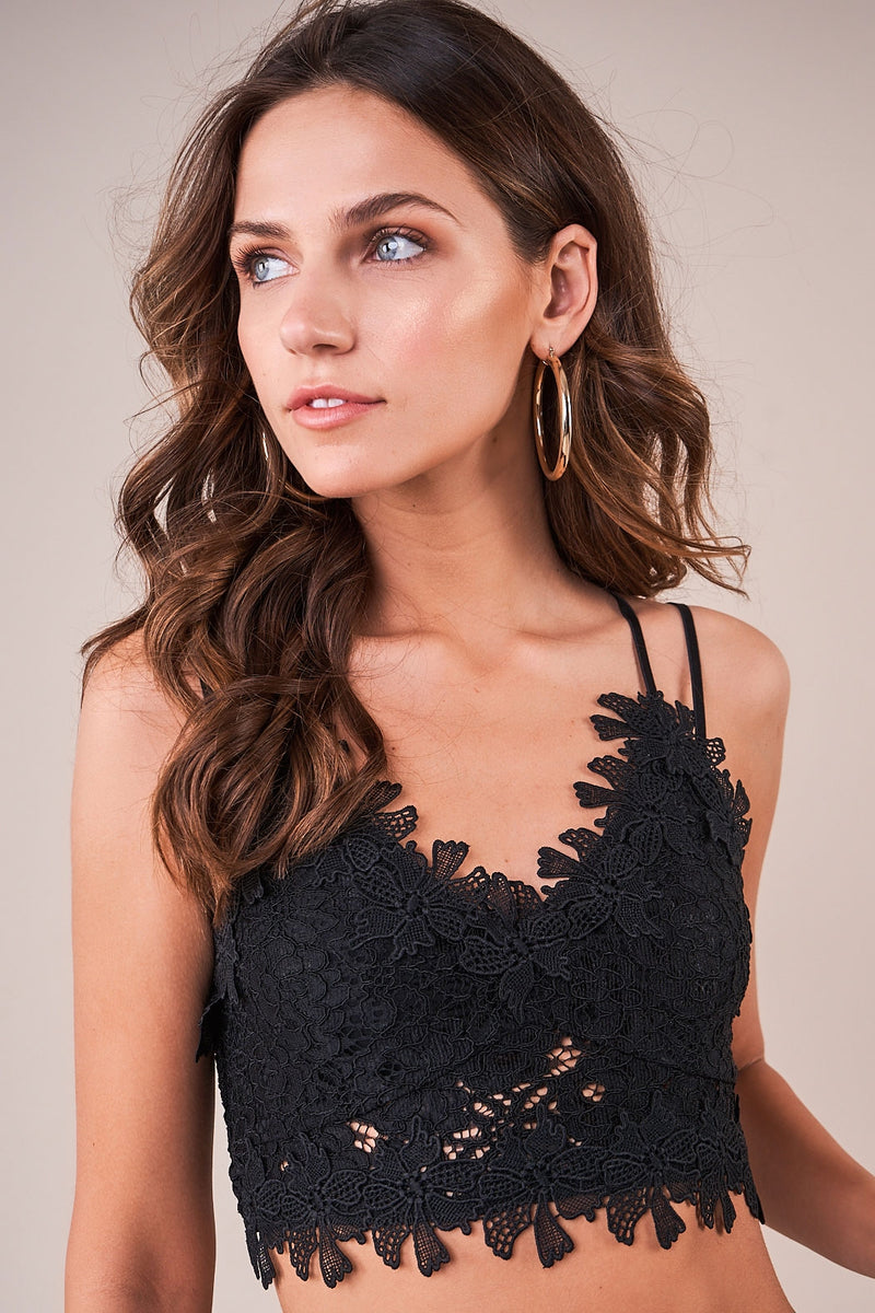 Add a little sweetness to your day with the Endless Love Lace Bralette! Romantic, crochet lace shapes darted, triangle cups, and a sheer bottom band while double, adjustable skinny straps cross over a smocked, elasticized back. Wear under any loose blouse.