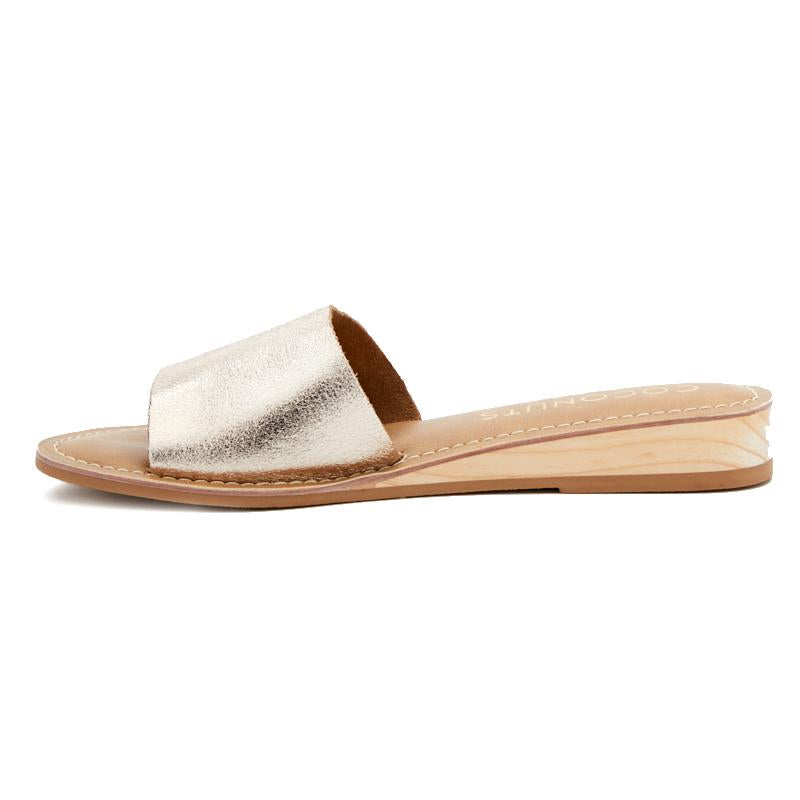 The Tiki Slide sandal is a best seller! It is enhanced with a very slight wedge which adds a little more dressier yet still casual feel. Shop Tiki- Coconuts Collection at Jax Kendall.