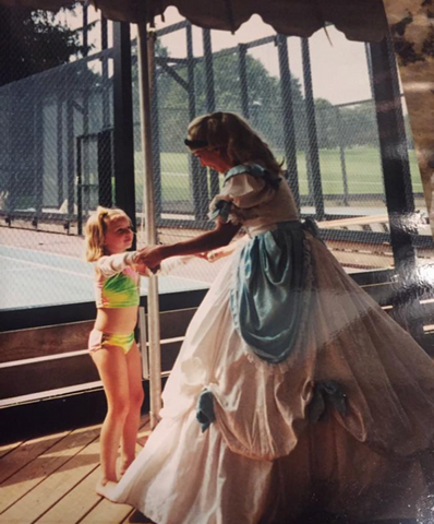 Little girl dancing with Cinderella