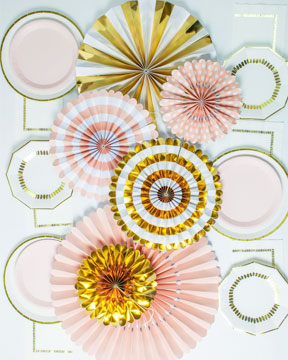 Pale pink and gold paper fans table centerpeices. White, gold, pale pink paper plates and white napkins with gold details.