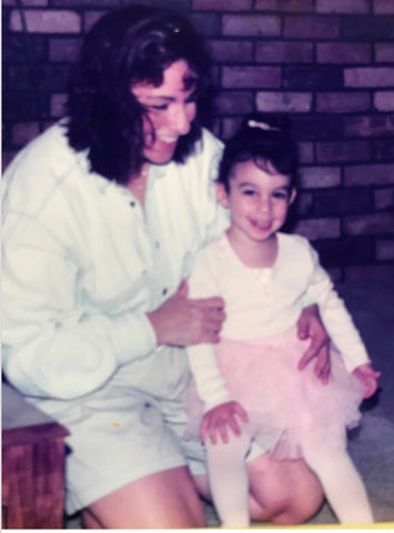 Little girl in ballerina outfit with mom