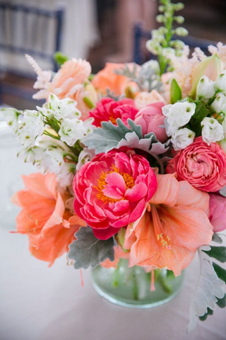 White, hot pink, and peach/coral  flower bouquet.
