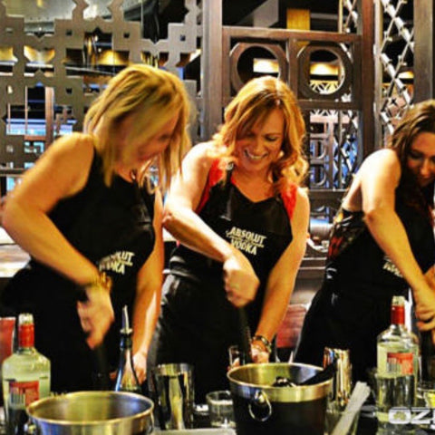 A group of women taking a mixology class