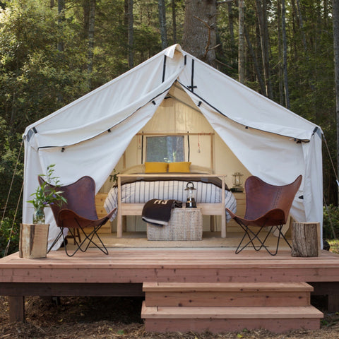 Glamping in style with elevated tent, leather chairs and full-sized bed