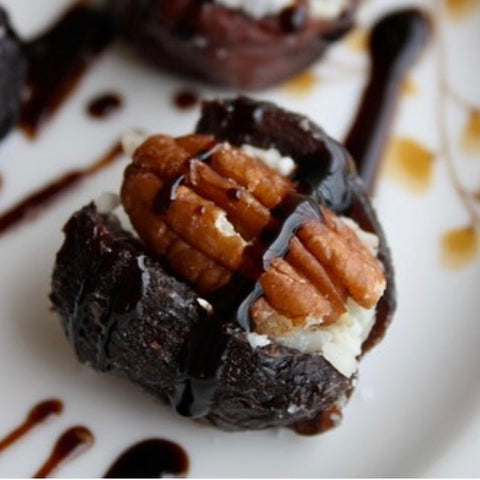Cheese stuffed fig with pecan and balsamic drizzle