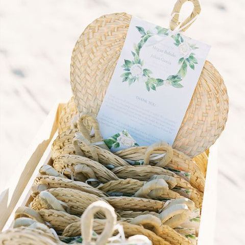 Straw fans for guests to take at wedding ceremony
