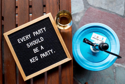 Blue rosé keg and letter board with saying for fun outdoor party.
