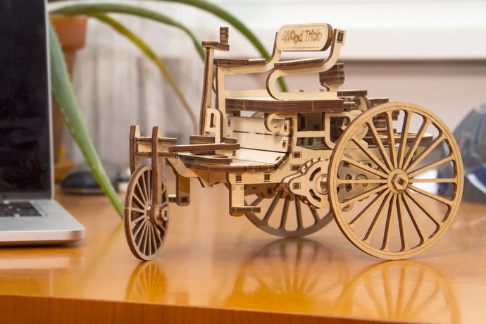 Open a window to vintage technologies and get a wooden model of the very first car ever built