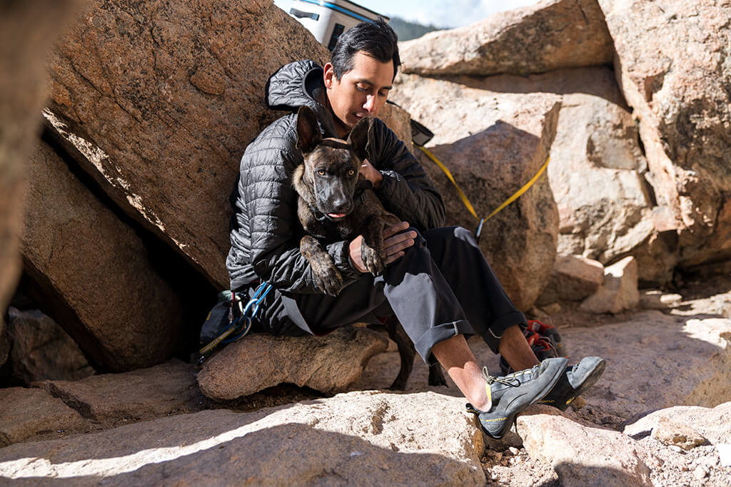 man and dog on hike